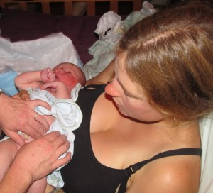 Mother holding a newborn baby.